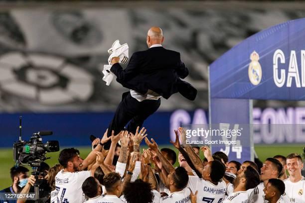 Head Coach of Real Madrid Zinedine Zidane celebrates with his team after winning La Liga Championship during La Liga match between Real Madrid CF and...