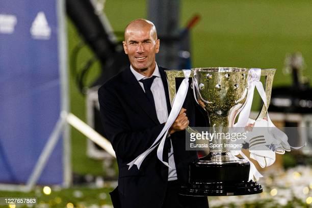 Head Coach of Real Madrid Zinedine Zidane celebrates with La Liga Champions Trophy during La Liga match between Real Madrid CF and Villarreal CF at...