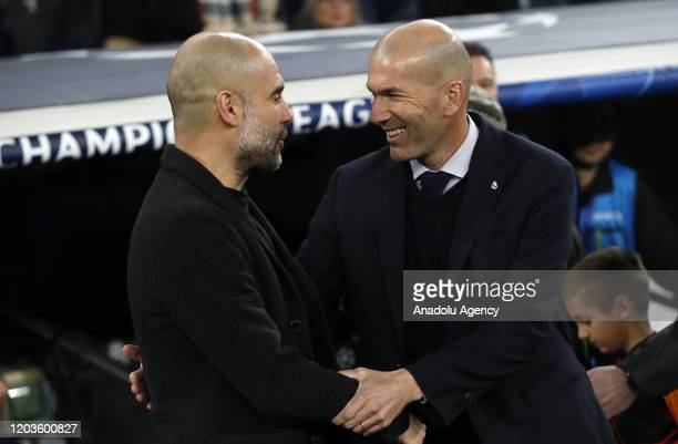 Head coach of Real Madrid Zinedine Zidane greets head coach of Manchester City Pep Guardiola ahead of the UEFA Champions League round of 16 first leg...