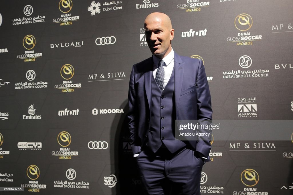Head Coach of Real Madrid Zinedine Zidane poses for a photograph after receiving 'Best Coach of the Year' award during the Globe Soccer Awards Ceremony at the end of the 12th Edition of the Dubai International Sports Conference in Madinat Jumeirah Resort in Dubai, United Arab Emirates on December 28, 2017.