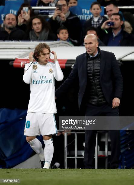 Head coach of Real Madrid Zinedine Zidane talks with Luka Modric during the La Liga soccer match between Real Madrid and Girona at Santiago Bernabeu...