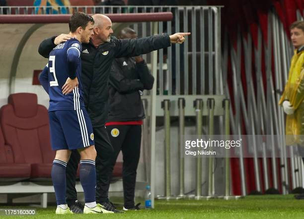 Head coach of Scotland Steve Clarke talks with Andy Robertson vie for the ball during the UEFA Euro 2020 qualifier between Russia and Scotland on...