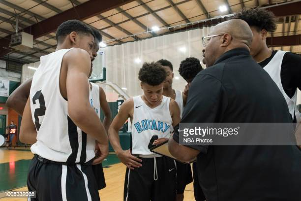 Head Coach of Seattle Rotary draws up plays during the game against Alaska Tru Game during the Jr NBA World Championship Northwest Regional Finals on...