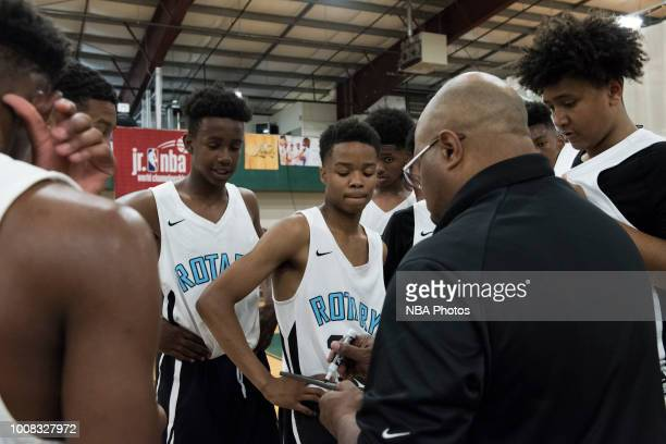 Head Coach of Seattle Rotary draws up plays for his team against Alaska Tru Game during the Jr NBA World Championship Northwest Regional Finals on...
