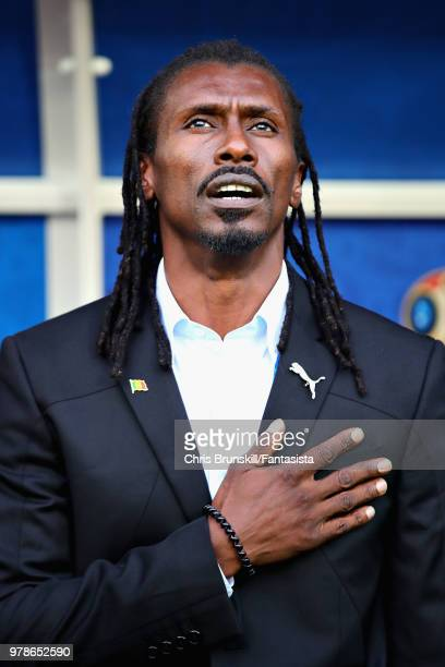 Head Coach of Senegal Aliou Cisse stands for the national anthem before the 2018 FIFA World Cup Russia group H match between Poland and Senegal at...