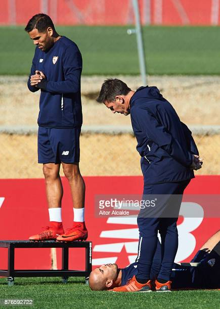 Head Coach of Sevilla FC Eduardo Berizzo speaks with Guido Pizarro of Sevilla FC during the training of Sevilla FC prior to their Champions League...