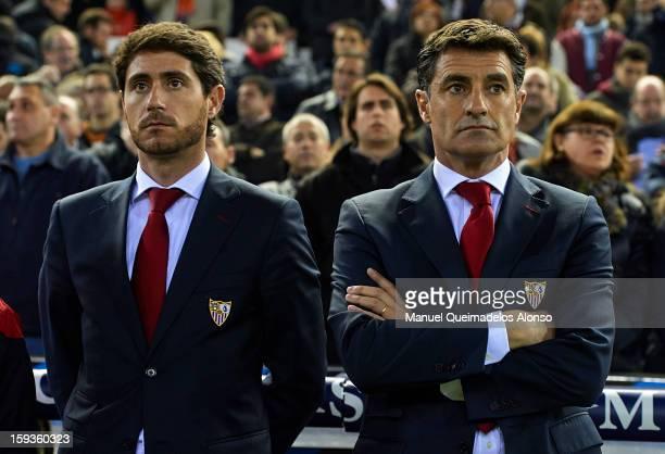 Head Coach of Sevilla FC Miguel Gonzalez Martin and assistant coach Victor Sanchez del Amo look on during the La Liga match between Valencia and...
