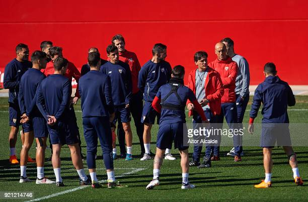 Head Coach of Sevilla FC Vincenzo Montella speaks with the players during a Sevilla FC training session prior to their UEFA Champions League match...