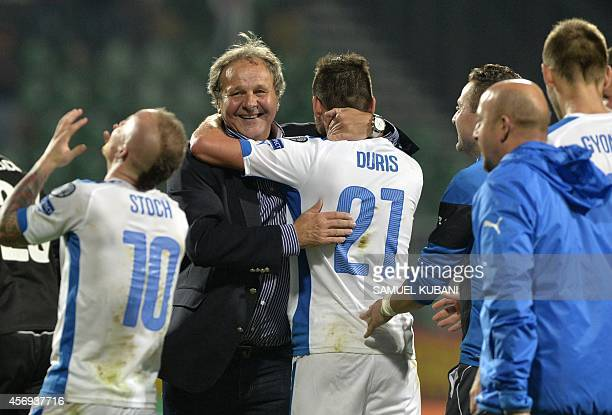 Head coach of Slovakia Jan Kozak celebrates with his team after the Euro 2016 qualifing football match between Slovakia and Spain in northern Slovak...