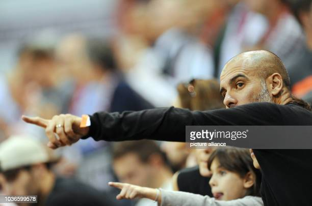 Head coach of soccer club FC Bayern Munich Pep Guardiola and his daughter Valentina watch the basketball Euro League group A match between FC Bayern...