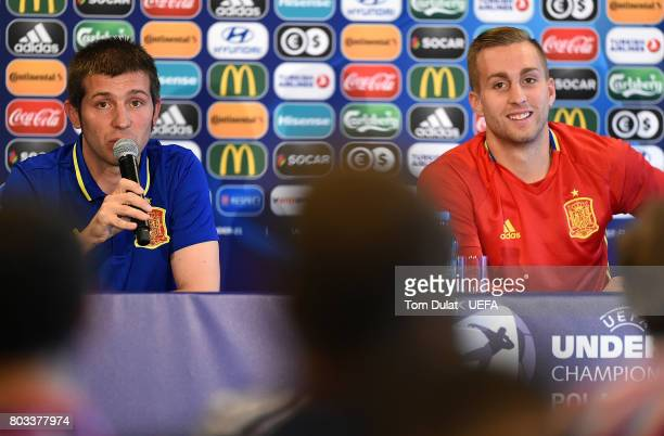 Head coach of Spain Albert Celades Lopez and team Captain Gerard Deulofeu speak to the media during a press conference at Krakow Stadium on June 29...