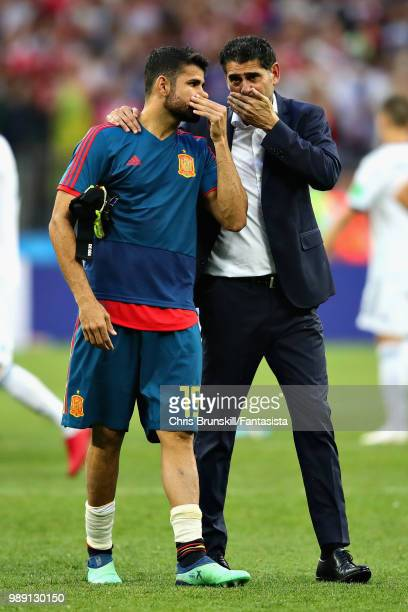 Head Coach of Spain Fernando Hierro looks dejected with Diego Costa of Spain after the 2018 FIFA World Cup Russia Round of 16 match between Spain and...