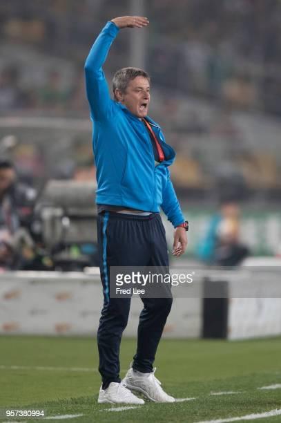 Head coach of Stojkovic of Guangzhou RF reacts during 2018 China Super League match between Beijing Guoan and Guangzhou RF at Beijing Workers Stadium...