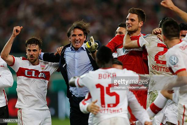Head coach of Stuttgart Bruno Labbadia celebrates wth his team after the DFB Cup Semi Final match between VfB Stuttgart and SC Freiburg at...