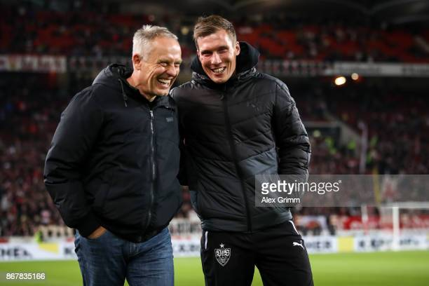 Head Coach of Stuttgart Hannes Wolf and Head Coach Christian Streich of Freiburg smile prior the Bundesliga match between VfB Stuttgart and SportClub...