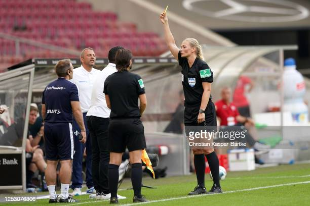 Head Coach of SV Darmstadt 98 Dimitrios Grammozis is shown a yellow card by referee Bibiana Steinhaus during the Second Bundesliga match between VfB...