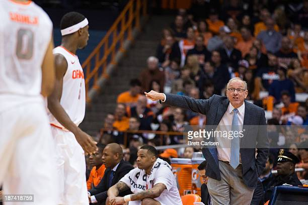 Head Coach of Syracuse Orange Jim Boeheim speaks to CJ Fair during a basketball game against Cornell Big Red on November 8 2013 at the Carrier Dome...