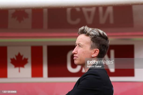 Head Coach of Team Canada Bev Preistman looks on prior to the Women's Football Semifinal match between USA and Canada at Kashima Stadium on August...