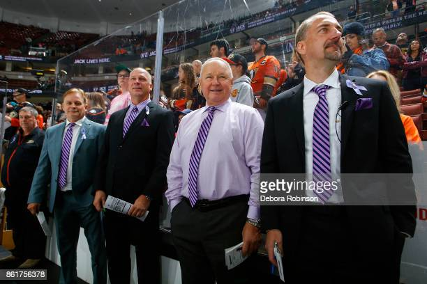 Head coach of the Anaheim Ducks Randy Carlyle center and assistant coaches Steve Konowalchuk Trent Yawney and Mark Morrison wear purple ties in...