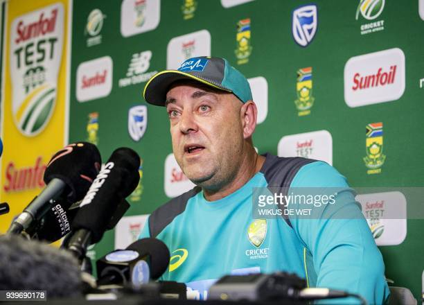 Head Coach of the Australia cricket team Darren Lehmann wipes his eyes as he responds to questions during a press conference in Johannesburg on March...