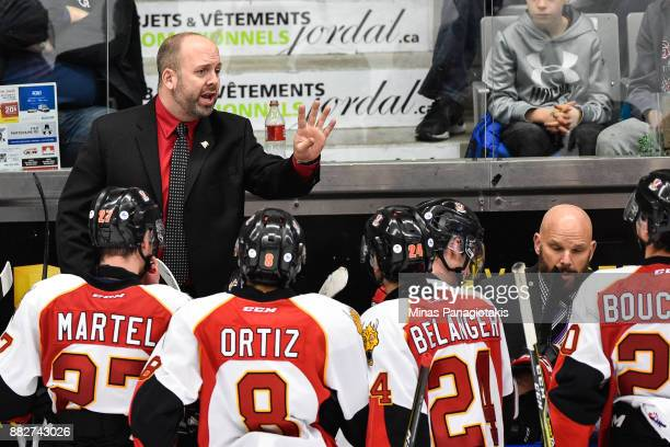 Head coach of the BaieComeau Drakkar Martin Bernard instructs his players against the BlainvilleBoisbriand Armada during the QMJHL game at Centre...