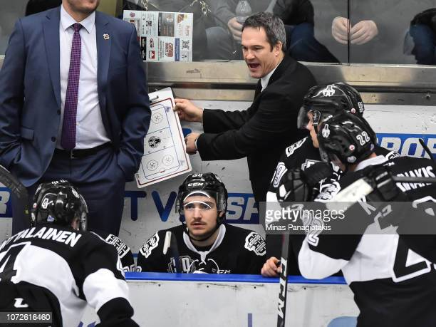 Head coach of the Blainville-Boisbriand Armada Bruce Richardson runs the play with his players against the Rimouski Oceanic during the QMJHL game at...