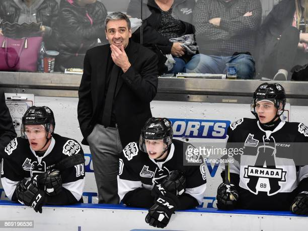 Head coach of the BlainvilleBoisbriand Armada Joel Bouchard looks on from behind the bench against the Drummondville Voltigeurs during the QMJHL game...