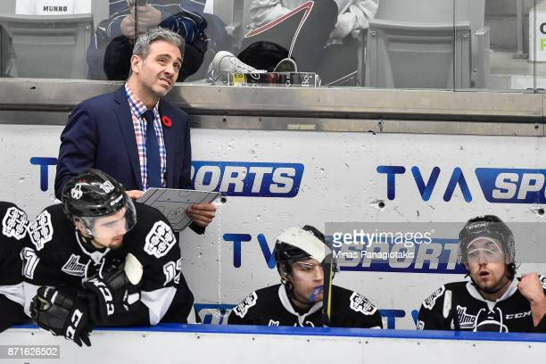 Head coach of the BlainvilleBoisbriand Armada Joel Bouchard looks on from behind the bench against the Gatineau Olympiques during the QMJHL game at...