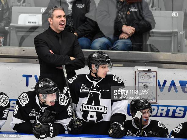 Head coach of the BlainvilleBoisbriand Armada Joel Bouchard yells out instructions from the bench against the Drummondville Voltigeurs during the...