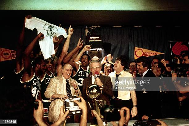 Head coach of the Boston Celtics Red Auerbach and his team celebrate after winning the 1981 NBA Championship on May 14 1981 in Houston Texas The...