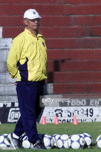 Head coach of the Brazilian soccer team Carlos Cesar walks in the middle of the soccer balls 26 June 2001 during a training session in Corodoba...