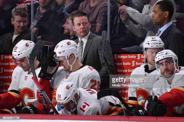 Head coach of the Calgary Flames Glen Gulutzan looks on from behind the bench against the Montreal Canadiens during the NHL game at the Bell Centre...