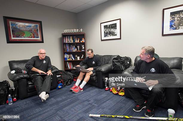 Head coach of the Chicago Blackhawks, Joel Quenneville, sits with assistant coaches Kevin Dineen and Mike Kitchen prior to the NHL Winter Classic...