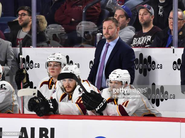 Head coach of the Cleveland Monsters John Madden looks on from behind the bench against the Laval Rocket during the AHL game at Place Bell on January...