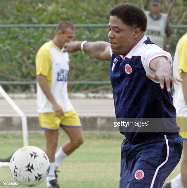 Head coach of the Colombian soccer team Francisco Maturana plays with the ball during a training session with his team 10 July on the grounds of the...