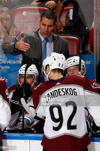 Head Coach of the Colorado Avalanche Jared Bednar directs his team from the bench during a break in the action against the Florida Panthers at the...