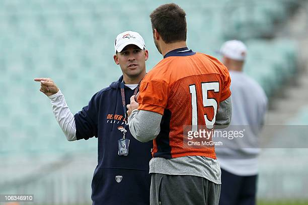 Head coach of the Denver Broncos Josh McDaniels talks with Tim Tebow during a team training session at The Brit Oval on October 29 2010 in London...