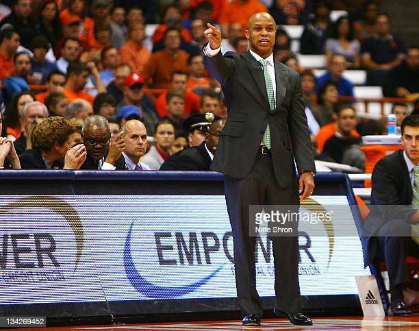 Head coach of the Eastern Michigan Eagles, Rob Murphy points from the sideline during the game against the Syracuse Orange at the Carrier Dome on...