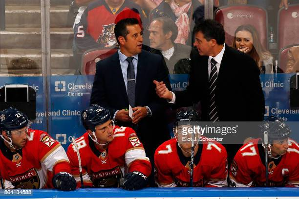 Head Coach of the Florida Panthers Bob Boughner and Associate Coach Jack Capuano chat during a break in the action against the Pittsburgh Penguins at...