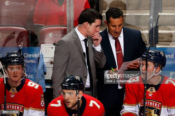 Head Coach of the Florida Panthers Bob Boughner chats with Assistant Coach Paul McFarland during a break in the action against the Colorado Avalanche...