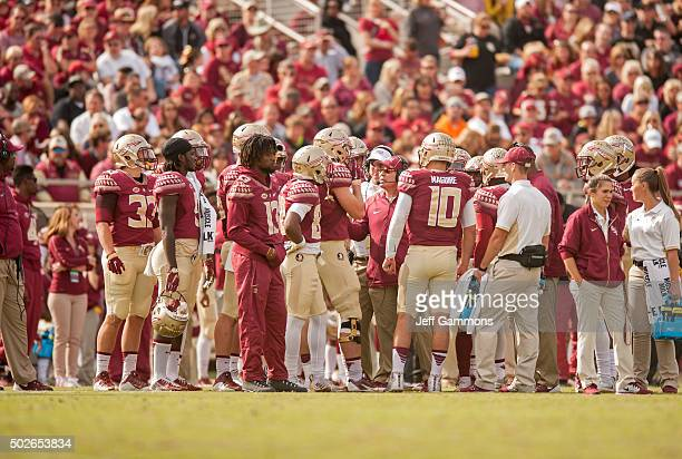 Head coach of the Florida State Seminoles Jimbo Fisher talks to quarterback Sean Maguire during the game at Doak Campbell Stadium on November 14 2015...