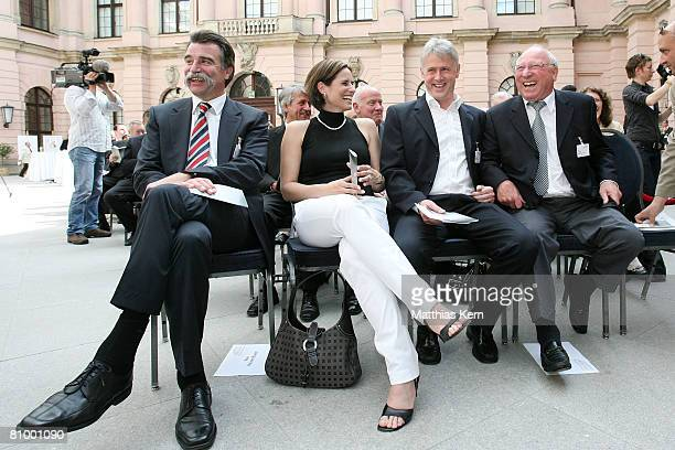 Head coach of the German national team Heiner Brand Roland Matthes and wife Marion and former football player Uwe Seeler smile during the...