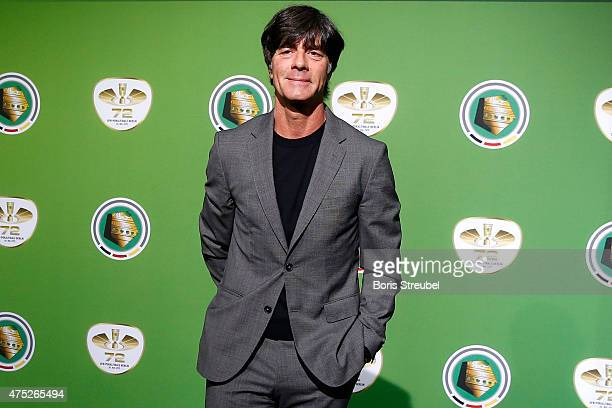 Head coach of the German National team Joachim Loew poses for a photo at the green carpet prior to the DFB Cup Final between Borussia Dortmund and...