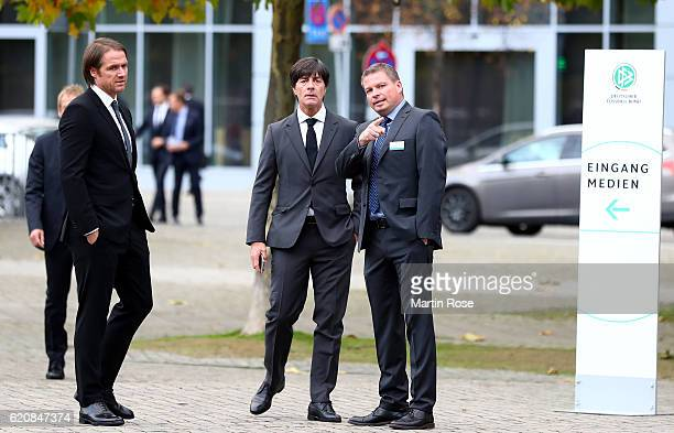 Head coach of the German National Team Joachim Loew talks to media director Jens Grittner whilst assistant coach Thomas Schneider looks on prior to...