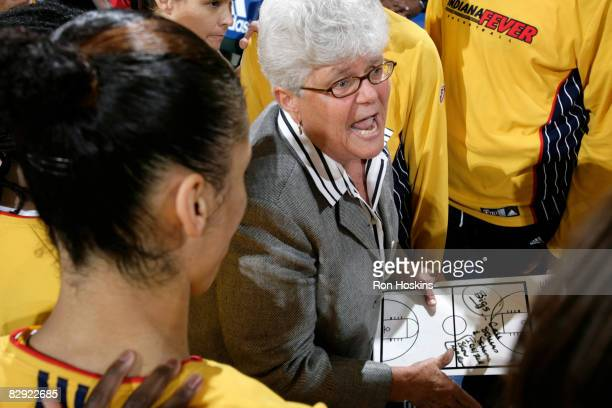 Head Coach of the Indiana Fever Lin Dunn speaks with her team prior to the Fever taking on the Detroit Shock in Game One of the Eastern Conference...