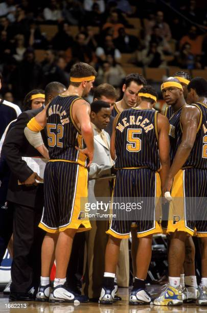 Head Coach of the Indiana Pacers Isiah Thomas talks strategy with his team during the game against the Toronto Raptors at Air Canada Centre on...