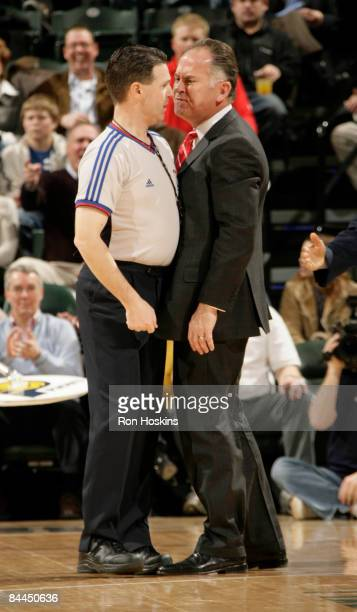 Head coach of the Indiana Pacers Jim O'Brien goes to nose to nose with NBA official Pat Fraher after what O'Brien thought should have been a foul on...