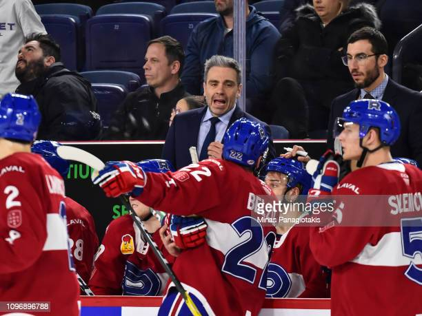 Head coach of the Laval Rocket Joel Bouchard gives out instructions to his players against the Cleveland Monsters during the AHL game at Place Bell...