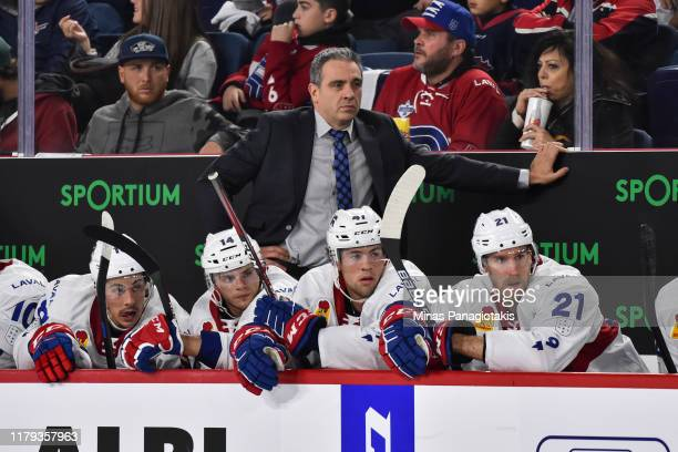 Head coach of the Laval Rocket Joel Bouchard looks on from the bench against the Cleveland Monsters in the second period at Place Bell on October 4...