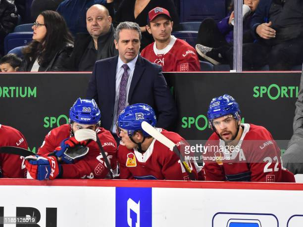 Head coach of the Laval Rocket Joel Bouchard looks on from the bench against the Hartford Wolf Pack during the second period at Place Bell on October...
